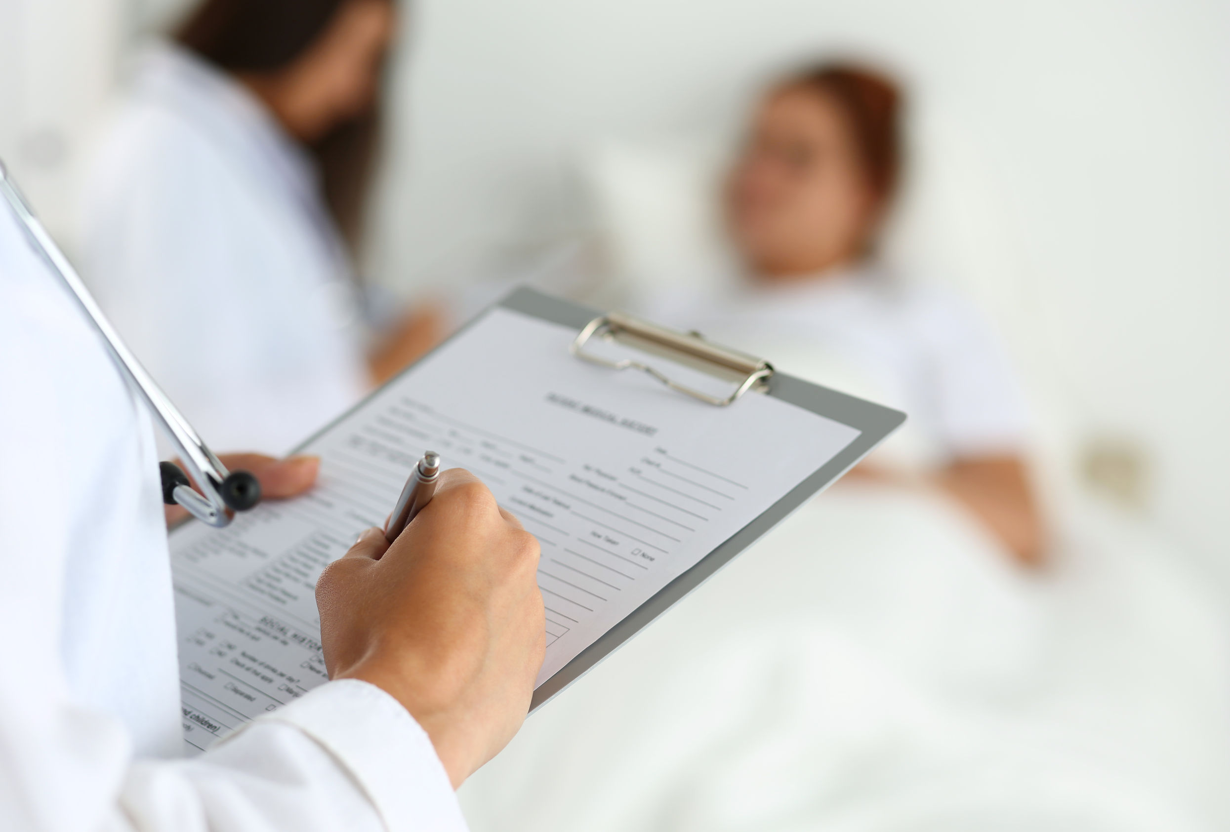 doctor completing patient form